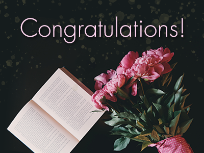 Congratulatory photo of a bouquet and a book